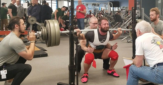 BRIAN PHILLIPS IS SHOWN BREAKING the A.P.A. squat world record on December, 15 in St. Louis, MO. Phillips owns and operates Warsaw Fitness.