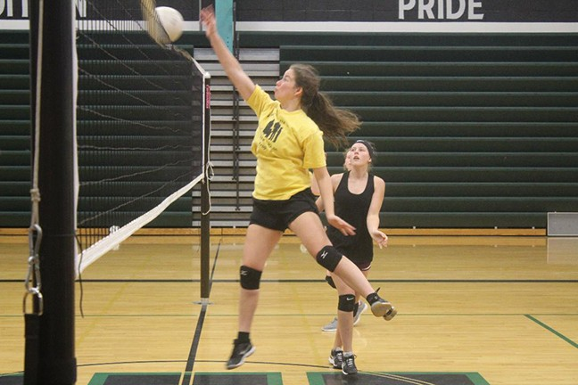 SENIOR KAMRYN YACH REACHES  OVER the net at the Warsaw high school volleyball camp last week. Yach was one of 15 girls attending the hands on volleyball seminars taught by various coaches.